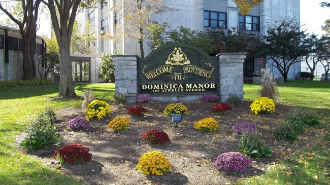Dominica Sign and Flower Bed1 (Medium).JPG